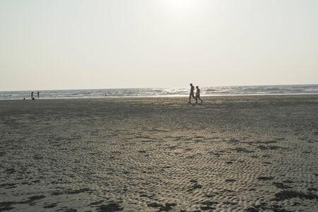 Evening walk on the ocean coast in the tropics