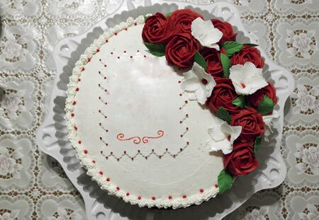 Festive beautiful and delicious cake decorated with cream flowers Stock fotó