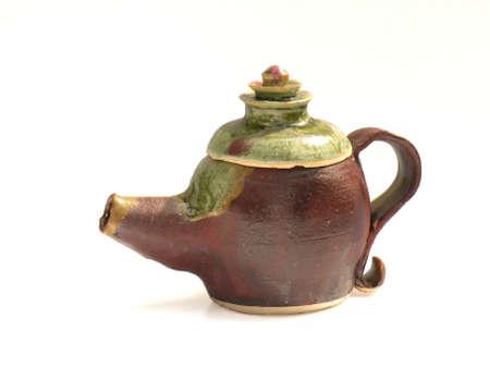 Clay Teapot on white background