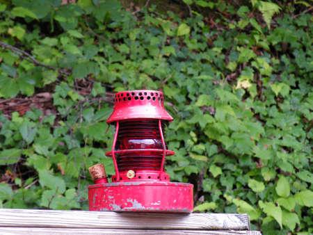 lighthouse lantern with woodsy background