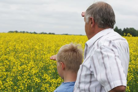 Grandson and grandfather looking far away photo