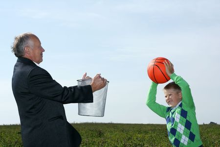 Grandfather and grandson playing basketball  photo