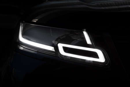 Moscow. Autumn 2018. Led headlights of the Land Rover Range Rover Velar in Black color compact luxury crossover SUV produced by automotive company Jaguar Land Rover under their Land Rover marque. Editorial