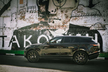 Moscow. Autumn 2018. The Land Rover Range Rover Velar in Black color compact luxury crossover SUV in the industrial zone
