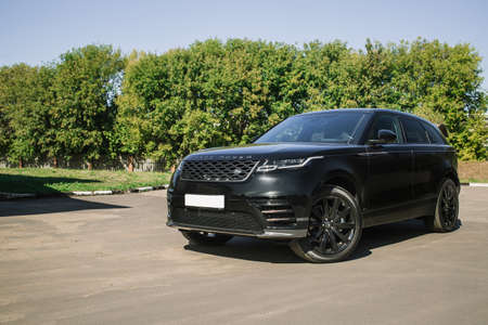 Moscow. Autumn 2018. The Land Rover Range Rover Velar in Black color compact luxury crossover SUV in the industrial zone Редакционное