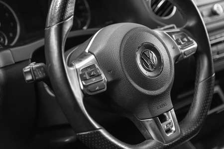 Moscow. November 2018. Multifunctional steering wheel Volkswagen. R-line. Leather. With paddle shifters and buttons to control the cruise control, music, phone. Stok Fotoğraf - 114234571
