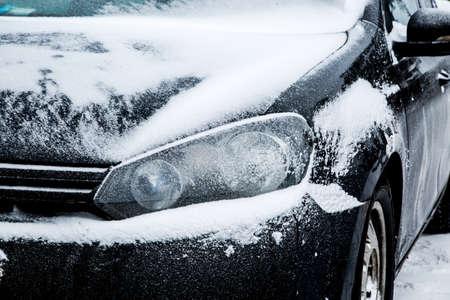 Black dirty car under the snow. Frozen car. winter problems to start engine Stock fotó