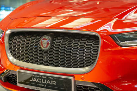 Singapore. March 2019. Orange Jaguar I-Pace all electric SUV. Front view, led headlights and grill with camera, hood and bumper.  Carbon wheels Cars of the future Editöryel
