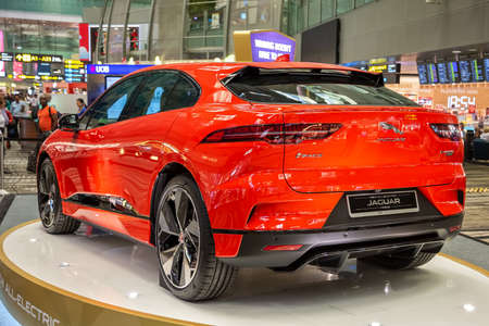 Singapore. March 2019. Orange Jaguar I-Pace all electric SUV. Back side view. Standed in Changhi airport. I Pace Car of the future Editöryel