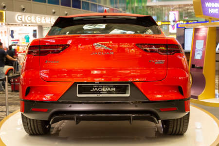 Singapore. March 2019. Orange Jaguar I-Pace all electric SUV. Taillights. trunk door and rear camera under bumper. Rear view. Editöryel