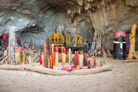 Krabi province, Thailand. Offerings, wooden phalluses display in the Princess cave Tham Phra Nang