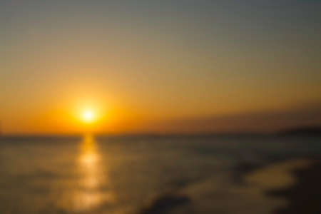 Blurred nature background. Beautiful golden sunset. Sun Path reflected in the water.
