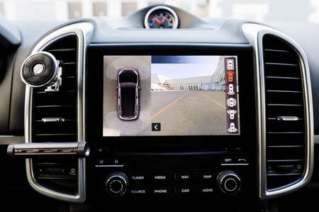 Interior of luxury car Working of front camera of circular 360 degrees view system. Image display on the head unit. Multimedia in the car.