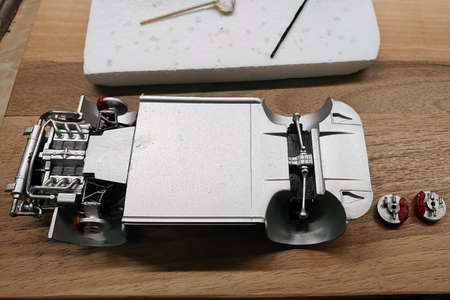 Build a scale model of the car. Glued and painted engine, exhaust system, suspension and brakes