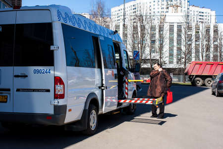 Moscow, Russia - April 16, 2019: Social taxi for the disabled. Special vehicles equipped for disabled people in wheelchairs.
