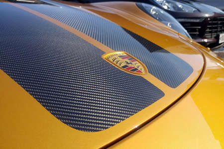Moscow, Russia - May 09, 2019: Golden Porsche 911 Exclusive series. Limited edition. Number three hundred thirty seven. In the world were produced only 500 cars. Carbon fiiber hood clode up
