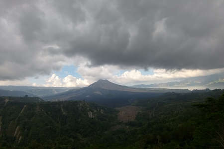Heavy clouds and scorched plain near Batur volcano on Bali island, Indonesia, Stok Fotoğraf