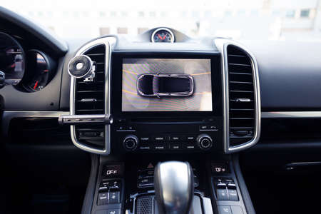 Working of a side mirror cameras to rear view. of surround 360 degrees view system. Image display on the head unit. Multimedia in the car. Help assist options inside premium automobile