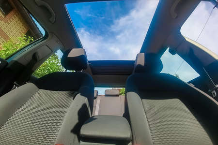 View of the sky from the open roof of the car.