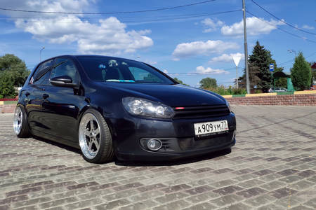 Moscow, Russia - June 04, 2019: Tuned and understated Volkswagen golf 6 black. Air suspension and custom polished alloy wheels parked on the street at sunny day