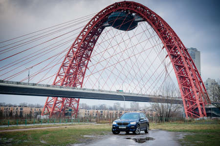 Moscow. Russia - December 06, 2019: The all-new BMW X3. Blue crossover stands on the street at night. Premium German SUV. and bridge