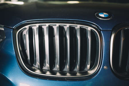 Moscow. Russia - December 06, 2019: The all-new BMW X3. Blue crossover stands on the street at night. Premium German SUV. front grill of premium car