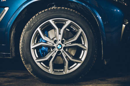 Moscow. Russia - December 06, 2019: The all-new BMW X3. Blue crossover stands on the street at night. Premium German SUV. Wheel close up, light alloy wheels