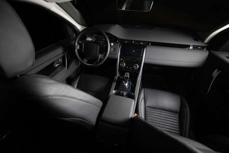 Dark luxury car Interior. Front seats of premium suv Leather panels. the view from the ceiling   Stockfoto