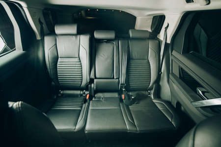 Moscow, Russia - December 20, 2019: Rear seats and leather interior of a premium car Land Rover Discovery Sport 2020. Editorial