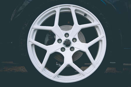 White alloy or forged wheels with tires on a car