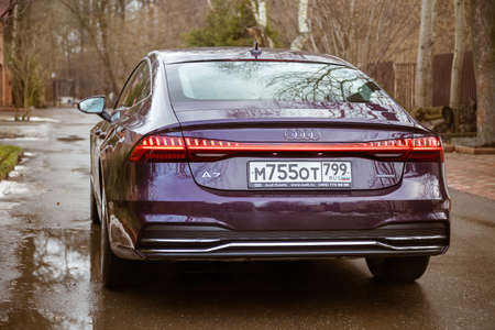 Moscow. Russia - January 16, 2020: Audi A7 Sportback Ultra Nova GT 1 of 111 A purple-colored premium car stands in the street  back side view Editorial