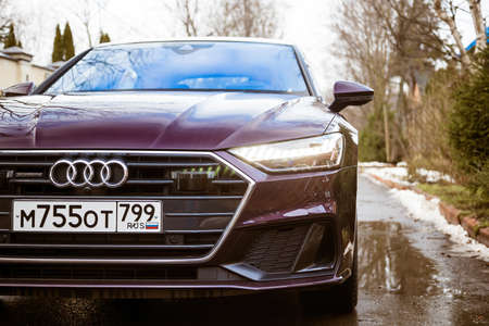 Moscow. Russia - January 16, 2020: Audi A7 Sportback Ultra Nova GT 1 of 111 A purple-colored premium car stands in the street  front side view