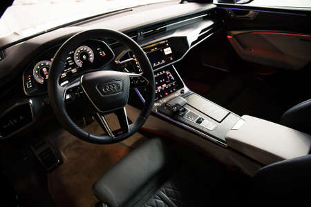 Moscow. Russia - January 16, 2020: Interior of a premium sedan Audi A7 Sportback Ultra Nova GT 1 of 111. Black leather seats and dashboard, led screens with touchpads. climate control and shifters Editorial