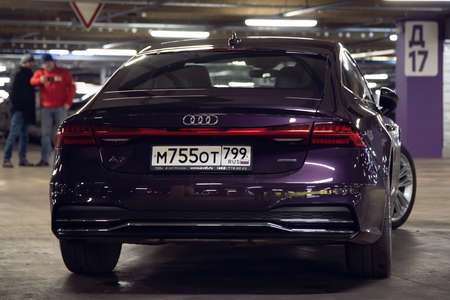 Moscow. Russia - January 16, 2020: Audi A7 Sportback Ultra Nova GT 1 of 111 A purple-colored premium car stands in the parking lot. Back side view. Led tail lights