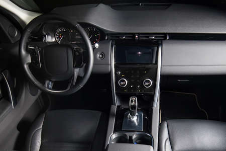 Interior of luxury suv car with black leather steering wheel and automatic shift gear. Standard-Bild