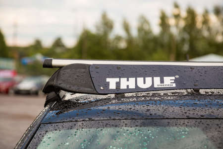 Moscow, Russia - July 06, 2019: Close-up. Part of the roof rack of a car manufactured by the Swedish company Thule. Wind cutter Editorial