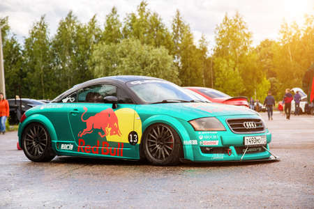 Moscow, Russia - July 06, 2019: Tuned Audi TT tightened by a special turquoise vinyl film. The car is sponsored by red bull racing. Parked on the street. Wrapping