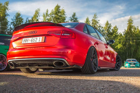 Moscow, Russia - July 6, 2019: Red sports Audi A4 Lowered and tuned stands in a parking lot forged wheels and air suspension Editorial