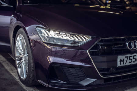 Moscow. Russia - January 16, 2020: Audi A7 Sportback Ultra Nova GT 1 of 111 A purple-colored premium car stands in the street  front side view close up
