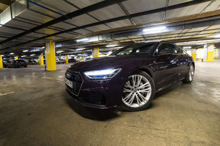 Moscow. Russia - January 16, 2020: Audi A7 Sportback Ultra Nova GT 1 of 111 A purple-colored premium car stands in the parking lot.  Front view