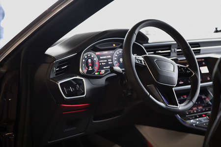 Interior of an ultra modern new luxury car. Leather chairs and wood trim, touch panels with vibration feedback and climate control. Multifunction, automatic transmission Standard-Bild