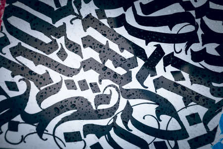 texture. black abstract patterns on a white background. Looks like lettering and calligraphy