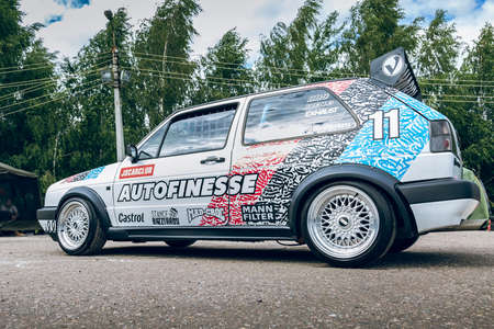 Moscow, Russia - July 06, 2019: White Volkswagen Golf 2 powerfully tuned for racing with a roll cage, an aerodynamic spoiler, an understated car with custom BBS wheels. Rally