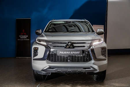 Moscow, Russia - February 17, 2021: All new Mitsubishi Pajero Sport. Details. Closeup of LED headlights, bumper, hood, radiator grill, taillights, side fenders, mirrors.