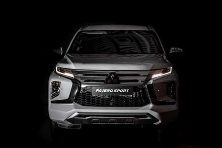Moscow, Russia - February 17, 2021: All new Mitsubishi Pajero Sport. Montero. Car stand at the parking box, dark light. Éditoriale