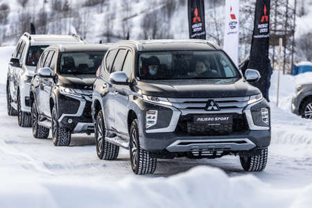 Moscow, Russia - February 17, 2021: All new Mitsubishi Pajero Sport. Facelifted suv. winter, the car is driving off-road. the front of the updated SUV.