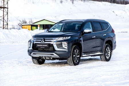 Moscow, Russia - February 17, 2021: All new Mitsubishi Pajero Sport. Facelifted suv. winter, the car is tested at the test site the front of the updated SUV. Front and half view
