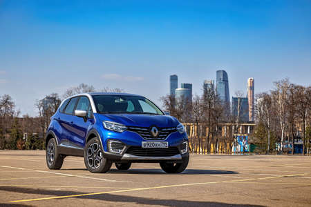 Moscow, Russia - April 11, 2021: Blue Renault Kaptur with a gray roof. The two-tone compact crossover is parked on the street. Front view Éditoriale