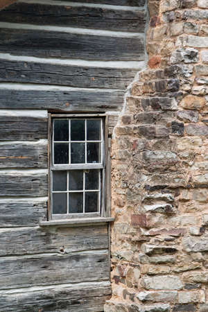 cement chimney: The window and rock chimney of and old log cabin.