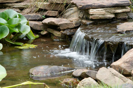 Clear water flowing over rocks.
